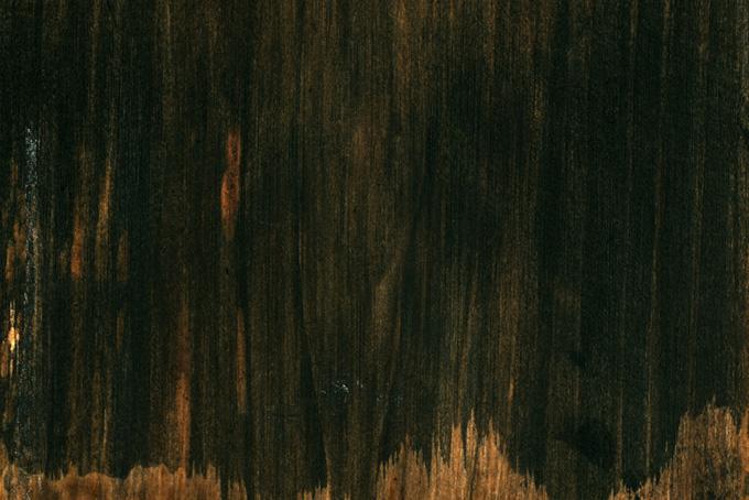 黒く塗られた板のテクスチャの背景