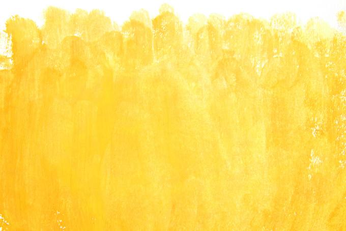黄色の絵具の掠れたテクスチャ
