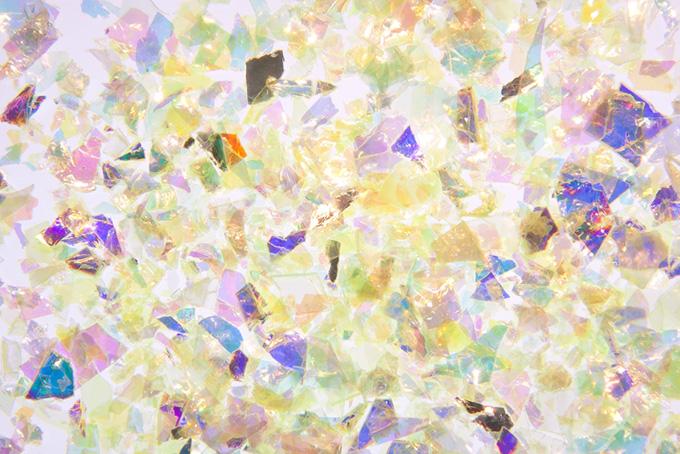 華やかな光彩の硝子フィルムのキラキラ背景