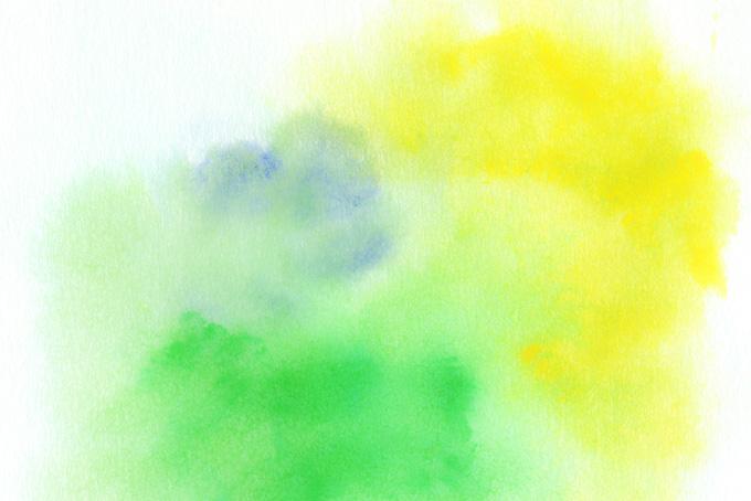 紙に滲む黄色と緑色の水彩写真(水彩の画像)