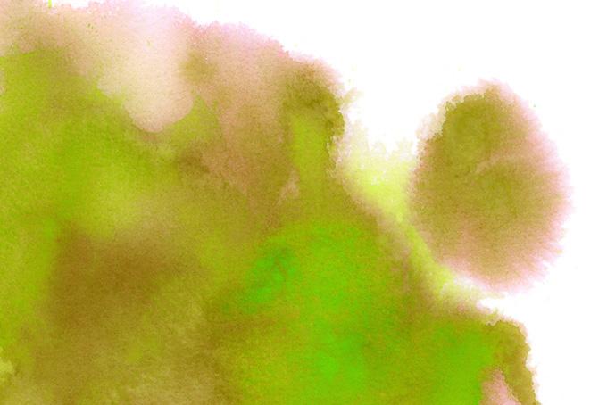 白紙に滲む黄緑色と茶色の絵具の背景(水彩の画像)