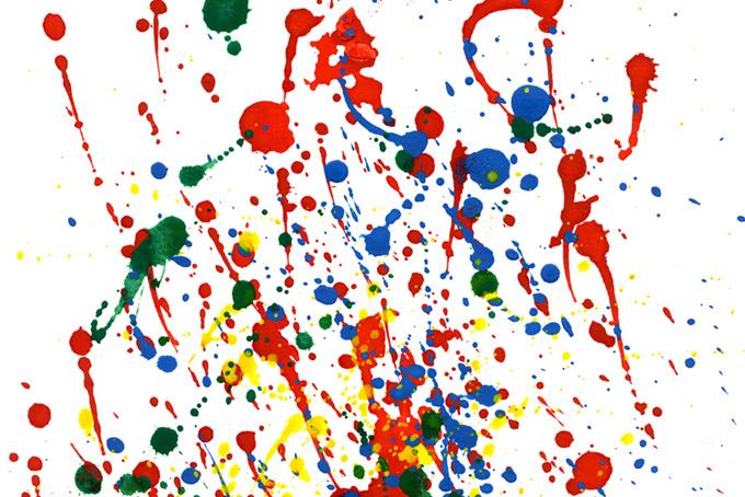 赤青緑黄の絵具が飛散った水彩背景