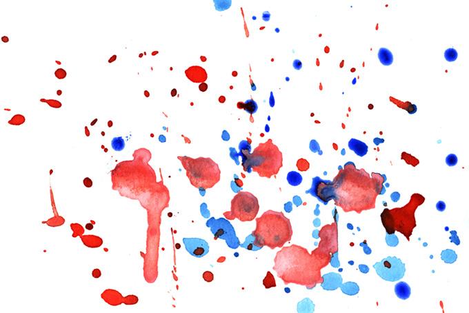 白い紙に落ちた赤と青の絵具