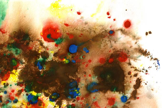 沢山の色が滲んで混ざり合う紙