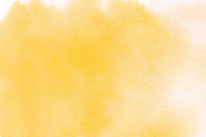 クロムイエローの水彩ぼかしの背景