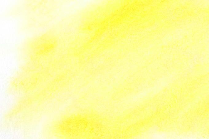 カナリヤ色の水彩ぼかし背景の画像