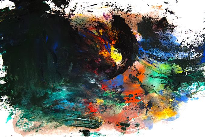 黒とカラフルな色が混色する絵具の画像