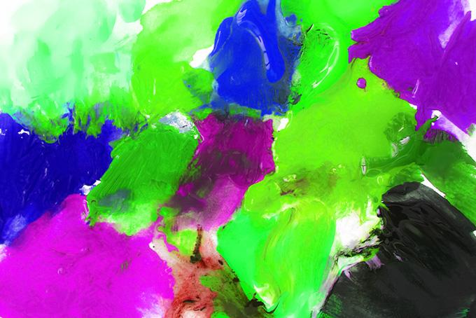 青紫緑の絵具を厚く塗った紙のポップな背景