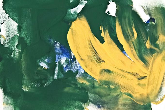 緑と黄の水彩絵の具が混ざる背景画像