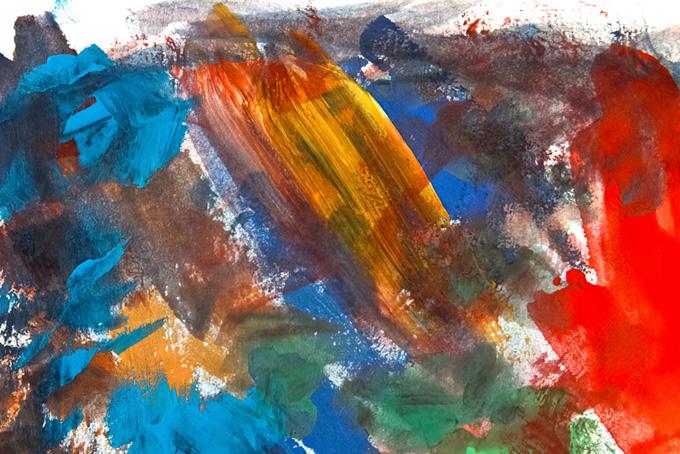 カラフルな青黄赤の絵具を厚く塗った紙
