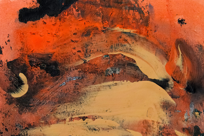 黒の上に重ね塗りしたオレンジの絵の具(水彩 絵の具のフリー画像)