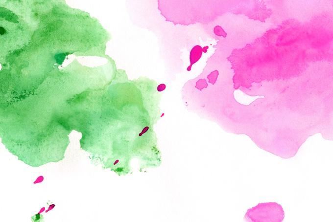 ピンクと緑の薄い水彩にじみの背景
