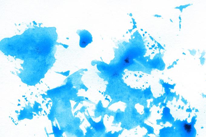 シアンの水彩スプラッタリングの背景