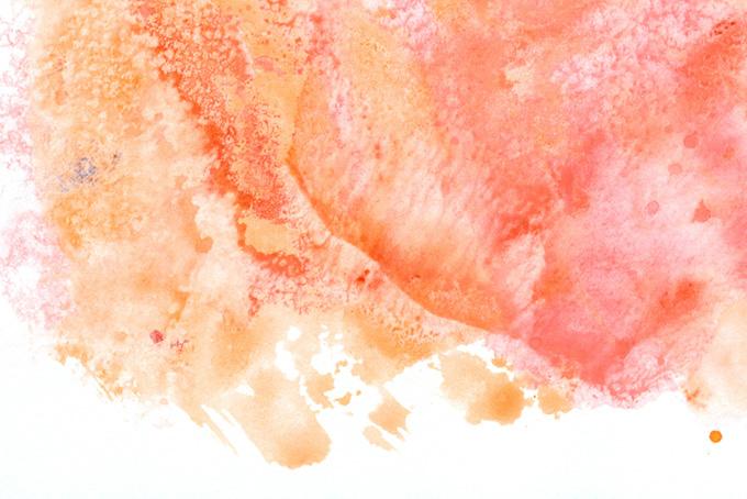 赤い絵具のにじみ模様と白背景の水彩画像(水彩 カラフルのフリー画像)