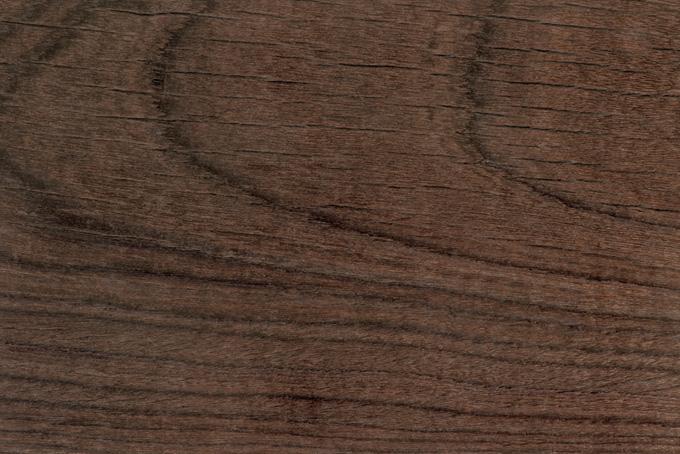 乾燥した焦げ茶色の木目背景
